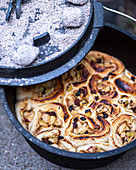Preparing cinnamon buns in the Dutch oven