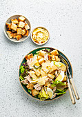 Fresh Caesar salad with lettuce salad, chicken breast, boiled eggs and croutons