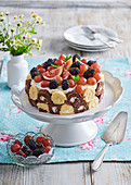 Cake with rolls and fruit