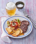Budapest sirloin medaillons with potato chips and vegetables