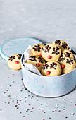 Christmas vanilla cinnamon cookies decorated with chocolate and sugar sprinkles