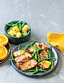 Harissa pork fillet with sweet potato and garlicky beans
