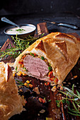 Pork fillet in puff pastry with onion sauce