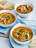 Hearty chicken soup with last-minute add-ins