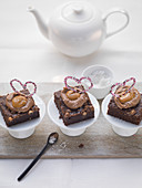 Brownie with caramel cream and heart decorations