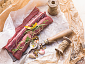 Raw saddle of venison with spices