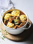 Marmite beef stew with cheesy dumplings