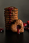 Chocolate and almond heart shaped cookies with cranberry syrup