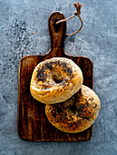 Poppyseed bagels on a breakfast board