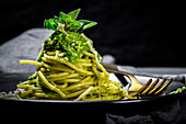 Pasta with pesto sauce and Parmesan cheese