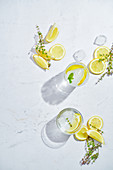 Glasses with refreshing cold thyme and ginger lemonade