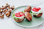 Mushrooms stuffed with lettuce and cheese with tomato slices
