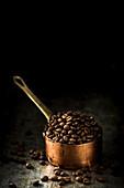 Fresh coffee beans in a copper saucepan