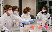Female laboratory students working in Biosecurity Research Institute