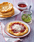 Hungarian Lángos with ketchup and cheese