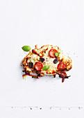 Cauliflower pizza with peperoni salami and mozzarella