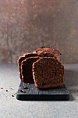 Chocolate box cake with cocoa nibs, cut