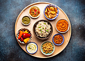 Indian Thali - Assorted vegetarian meze with boiled basmati rice, paneer, dal and chutney