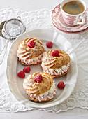 Profiteroles with raspberry cream and whipped cream