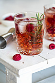 Gin & Tonic with raspberries and rosemary