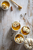 Small pumpkin cheesecakes with whipped cream