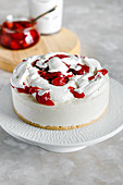 Vanilla coconut cheesecake with strawberry and whipped cream