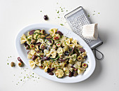 Farfalle with an aubergine and courgette sauce and olives
