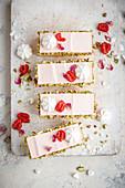 Vanilla cake with raspberry rosewater cheesecake topping