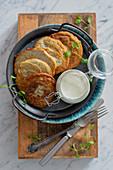 Potato and zucchini pancakes with yoghurt sauce