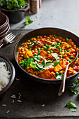 Vegeterian curry with chikpeas, peas, tomatoes, coriander and Indian Paneer cheese