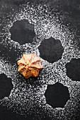 A hazelnut macaroon with icing sugar