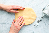 Shortcrust pastry being shaped to help it cool down quicker