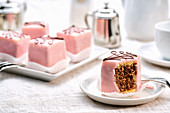 Petit fours with pink icing