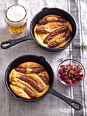 Sausages in beer batter with onion jam