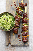 Yakitori steak skewers with a pointed cabbage salad