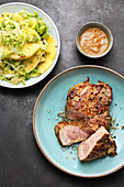 Hawaii collar steaks with a pineapple and avocado salad