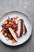 Sous vide pork steaks with a coffee rub served with a red cabbage and mango salad