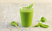 A green smoothie made from baby spinach, avocado, ginger and rice milk
