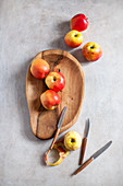 Fresh apples in a wooden bowl