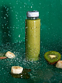 Glass jar with delicious healthy drink made from fresh bananas and kiwi detoxing body and eliminating thirst