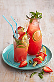 Summer garden drink with strawberries and lemons