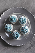 Meringue nests with pastel blue cream