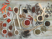 An arrangement of spices with various different types of pepper and chilli