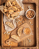 Typical Catalan biscuits carquinyolis with roasted almonds served on wooden tray