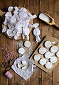 Polvorones wrapped in paper for Christmas holiday and placed on table with flour