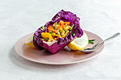 Purple cabbage leaf filled with mix of peppers and lentils