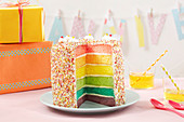 A rainbow cake covered in sprinkles
