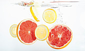 Citrus slices falling into fresh water