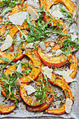 Oven-baked pumpkin wedges with rocket and Parmesan
