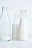 Almond milk in glass bottles